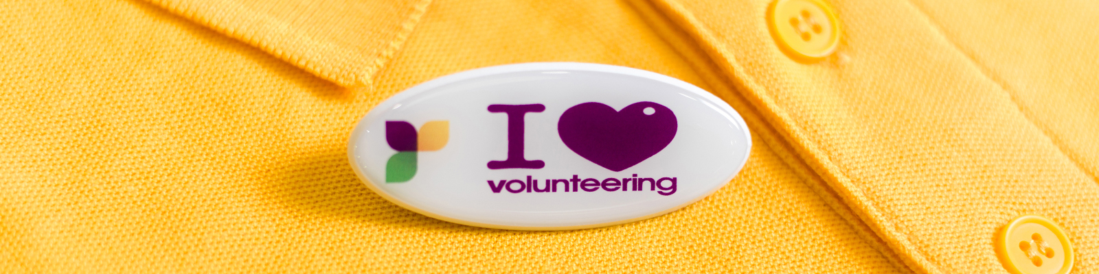 Photograph of a badge saying I Love Volunteering